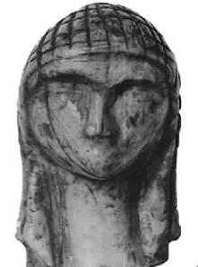 A small ivory head of a female figure with delicately carved features and stylized long hair, found at Brassempouy in France circa 22,000 BC. This piece is exceptionally valuable as racial characteristics are clearly identifiable in the face.